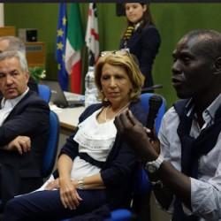 assessessore spanu con migranti